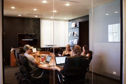 people in a meeting casually dressed in an office