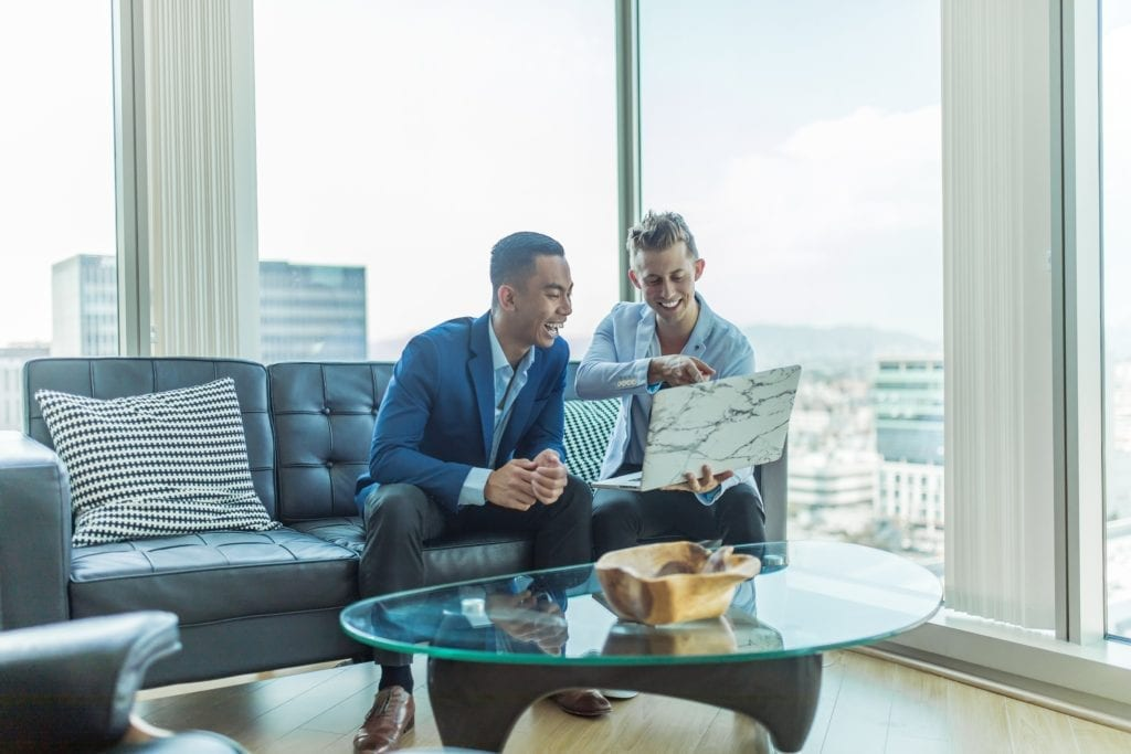 investor and entrepreneur sitting on couch